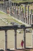 Exploring amongst the doric stoas that surround the stadium, at Ancient Messene, Messinia, Peloponnese, Greece.