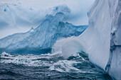 Huge swell breaking on tabular iceberg broken off from B-17A Iceberg near Cooper Bay, South Georgia.