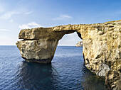 The island of Gozo in the maltese archipelago. Azure Window, an iconic natural arch or sea bridge at the coast of Gozo Europe, Southern Europe, Malta, April.