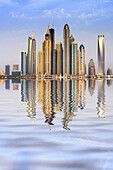 Skyline view with reflections of many skyscrapers in Marina district of Dubai United Arab Emirates.