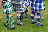Female highland dancers in kilts before competition at Braemar Junior Highland Games in July in Scotland United Kingdom.