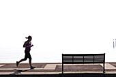 Woman jogger on Southsea Promenade.
