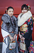 Women in furisode kimono, Seijin no hi day, celebration of the coming of age, second Monday of January, in Asakusa Senso-ji Temple, Tokyo, Japan.