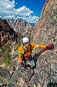 climbing the Chockstone Couloir, AKA the Boy Scout Couloir an alpine route which is rated Grade 3, Class 4 and located on The Grand Mogul in the Sawtooth Mountains in central Idaho.