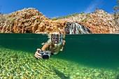 National Geographic Orion staff CT Ticknor enjoying a swim at Crocodile Creek, Yampi Bay, Kimberley, Western Australia, Australia.