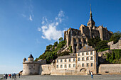Abbey Mont-Saint-Michel, Unesco World Heritage, 2014 new bridge for pedestrians and shuttle buses, mudflats, low tide, tourist attraction, Normandy, France