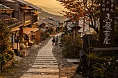 Tourists at end of day´s walk between Magome and Tsumago, old post road between Kyoto and Tokyo, Northern Japan Alps, Japan,.