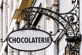 old fashioned sign of chocolate shop in Geneva, Switzerland