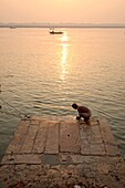 Bathers in the Ganges early in the morning at one of the ghats of Varanasi.