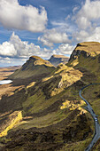The Quiraing a landslip on the eastern face of Meall na Suiramach, A view over Loch Leum na Luirginn and Loch Cleat, northeast coast of Trotternish Peninsula, Isle of Skye, Inner Hebrides, Scotland, United Kingdom, Europe.