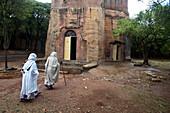 Orthodox christian women going to the mass in a rock hewn church i.e. Chirkos church. Wukro, Tigray state, Ethiopia.