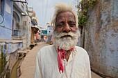 Elderly man in a narrow street of Bundi.