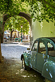 Les Deux Chevaux - old underpowered French car parked facing the public square - Place Favier, in Saint Remy de-Provence, France.