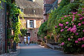View down street in medieval town of Collonges-la-Rouge, in the ancient Department of Limousin, Correze, France.