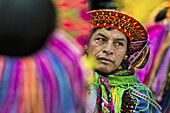 "A Colombian Kamentsá native, wearing a colorful headgear, takes part in the Carnival of Forgiveness, a traditional indigenous celebration in Sibundoy, Colombia, 12 February 2013. Clestrinye (""Carnaval del Perdón†?) is a ritual ceremony kept for centuries"