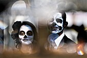 A young couple, costumed as â.La Catrinaâ., a Mexican pop culture icon representing the Death, walks through the town during the Day of the Dead celebration in Morelia, Michoacán, Mexico, 1 November 2014. Day of the Dead (â.Día de los Muertosâ.) is a sync