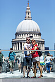 A Couple Photograph Themselves (selfie) On The Millennium Bridge With St Paul´s Cathedral In The Backround, London, England.