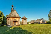 Church from Rogow and belfry from Kazimierza Wielka in Tokarnia open-air museum, Poland.