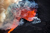 Aerial view of lava and plumes. August 29, 2014 a fissure eruption started in Holuhraun at the northern end of a magma intrusion, which had moved progressively north, from the Bardarbunga volcano. Bardarbunga is a stratovolcano located under Vatnajokull,