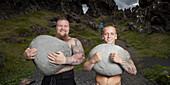 Brothers carrying heavy stones, Iceland.
