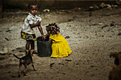 Two little native children washing their hands in a bucket, Sao Tome, Sao Tome and Principe, Africa