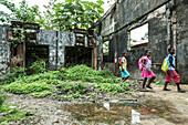 Three little girls going through a ruin, Sao Tome, Sao Tome and Principe, Africa