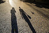 Shadow of a young photographer and a woman, Sao Tome, Sao Tome and Príncipe, Africa