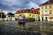 Trams pass thru Letenska and Klarov junction in Prague.