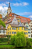 The Neckar river waterfront of Tubingen, Germany, showing its landmarks the Collegiate Church and Holderlinturm tower.