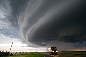 Supercell storm moves north of McCook Nebraska as a UPS driver zooms through falling hail stones.