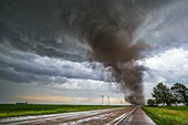 Tornado from a tornadic supercell approaches from the south, west of York Nebraska June 20, 2011.