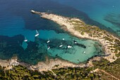 Aerial shot of a beach with anchored boats in the northeast of Mallorca (Majorca, Balearic Island).