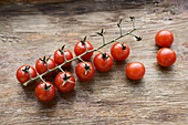 cherry tomatoes on a wooden background.