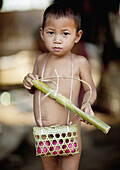 Akha Minority Boy With A Basket Of Eggs, Muang Sing, Laos.