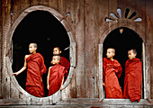 These novices are standing in the famous old teak wood Shwe Yan Pyay Monastery, near Inle Lake in Myanmar´s Shan State, during Thingyan, the Burmese New Year, many Burmese boys celebrate shinbyu, a special rite of passage when a boy enters a monastery for