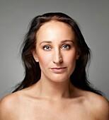 Portrait, natural beautiful woman face, head and shoulder shot.
