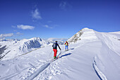 Two persons back-country skiing ascending to Sonnenjoch, Sonnenjoch, Kitzbuehel Alps, Tyrol, Austria