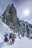 Several persons back-country skiing standing in Mandlkogelscharte, Mandlkogelscharte, Gosau range, Dachstein, Salzburg, Austria