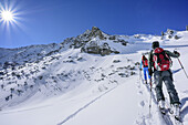 Two persons back-country skiing ascending to Breitenstein, Breitenstein, Chiemgau Alps, Chiemgau, Upper Bavaria, Bavaria, Germany