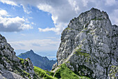 Two persons hiking at Gabelschrofensattel, Gabelschrofensattel, Ammergau Alps, East Allgaeu, Allgaeu, Swabia, Bavaria, Germany