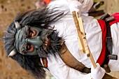 warrior jurru by attacking with wooden tongs in carnival of Alija del infantado, Leon, Spain