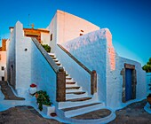 Chapel in the town of Chora on Patmos island in Greece. Patmos is a small Greek island in the Aegean Sea. One of the northernmost islands of the Dodecanese complex, it has a population of 2,998 and an area of 34. 05 km2 (13. 15 sq mi). The Municipality of
