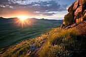 Landscape photo of a sunset atop the Drakensberg escarpment. Elliot, Eastern Cape, South Africa.