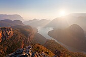 Landscape photo of a hazy winter sunrise over Blyde River Canyon. Mpumlanga, South Africa.