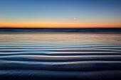 Landscape photo of a rippled beach in pastel nightfall colours. Jacobsbaai, West Coast, South Africa.