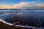 Landscape photo of warm morning colours on a beach. Kenton on Sea, Eastern Cape South Africa.