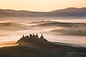 Landscape photo of a misty morning in the farmlands of Tuscany. Val D´Orcia, Tuscany, Italy.