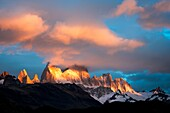 Landscape image of Mount Fitz Roy in cloud and sunrise colour. El Chalten, Patagonia, Argentina.