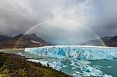 Landscape photo of a double rainbow over the glacier. Perito Moreno Glacier, Patagonia, Argentina.