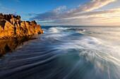 Landscape photo of a dramatic seascape sunrise. Arniston/Waenhuiskrans, Western Cape, South Africa.